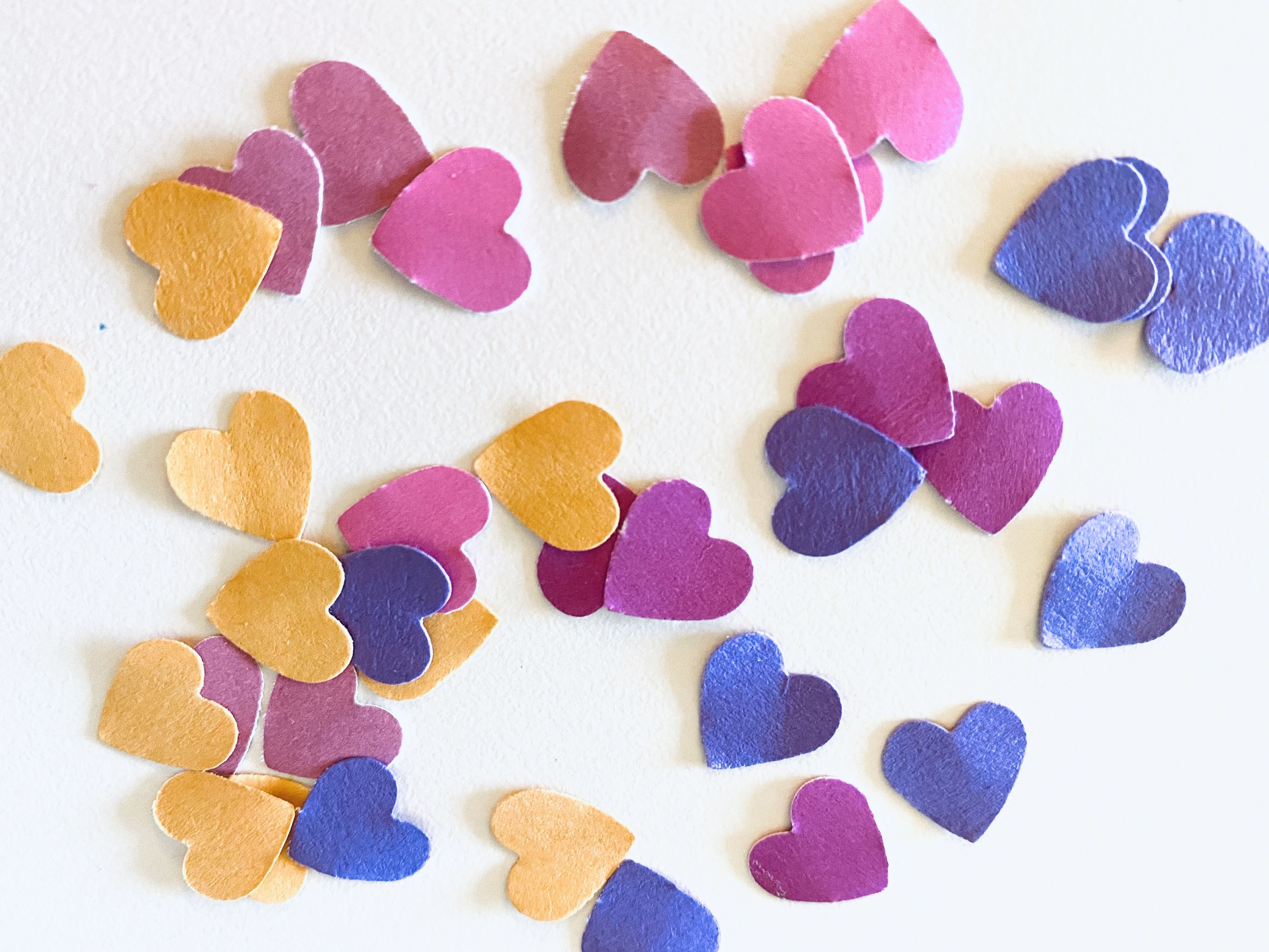Yellow orange pink and purple cardstock hearts punch