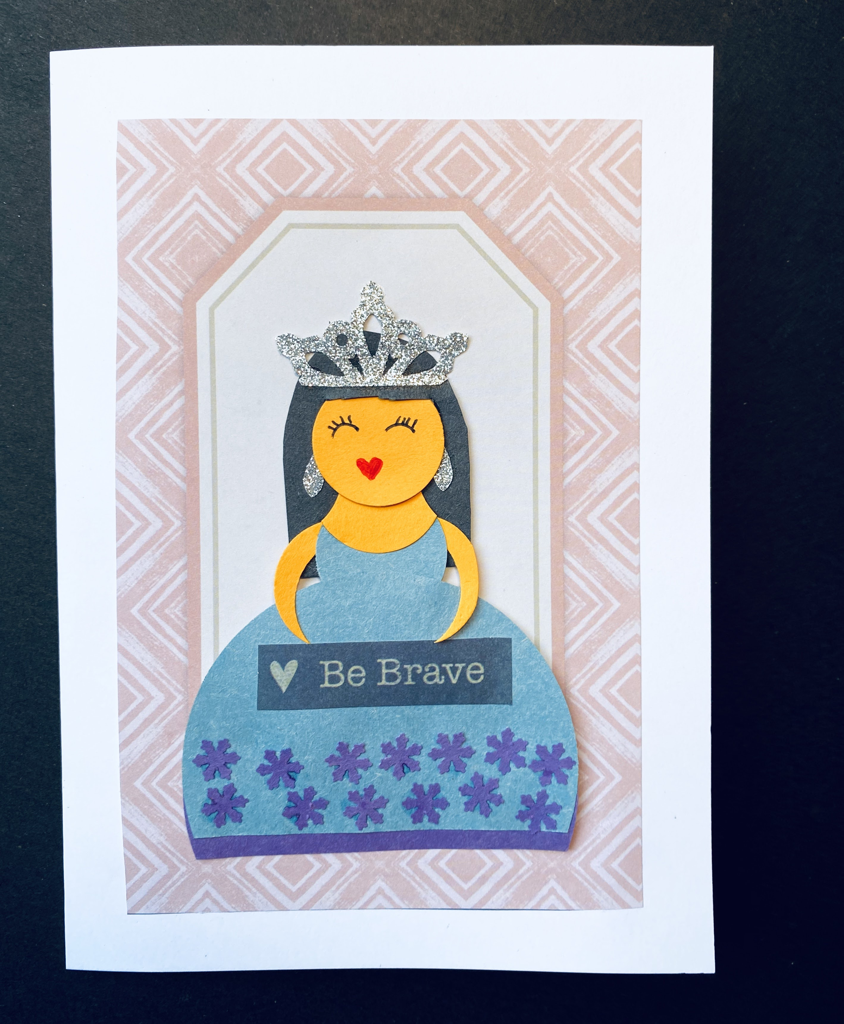 """The final results of our """"be brave"""" princess card made from paper.  She seeks to encourage the recipient of the card to be brave!"""