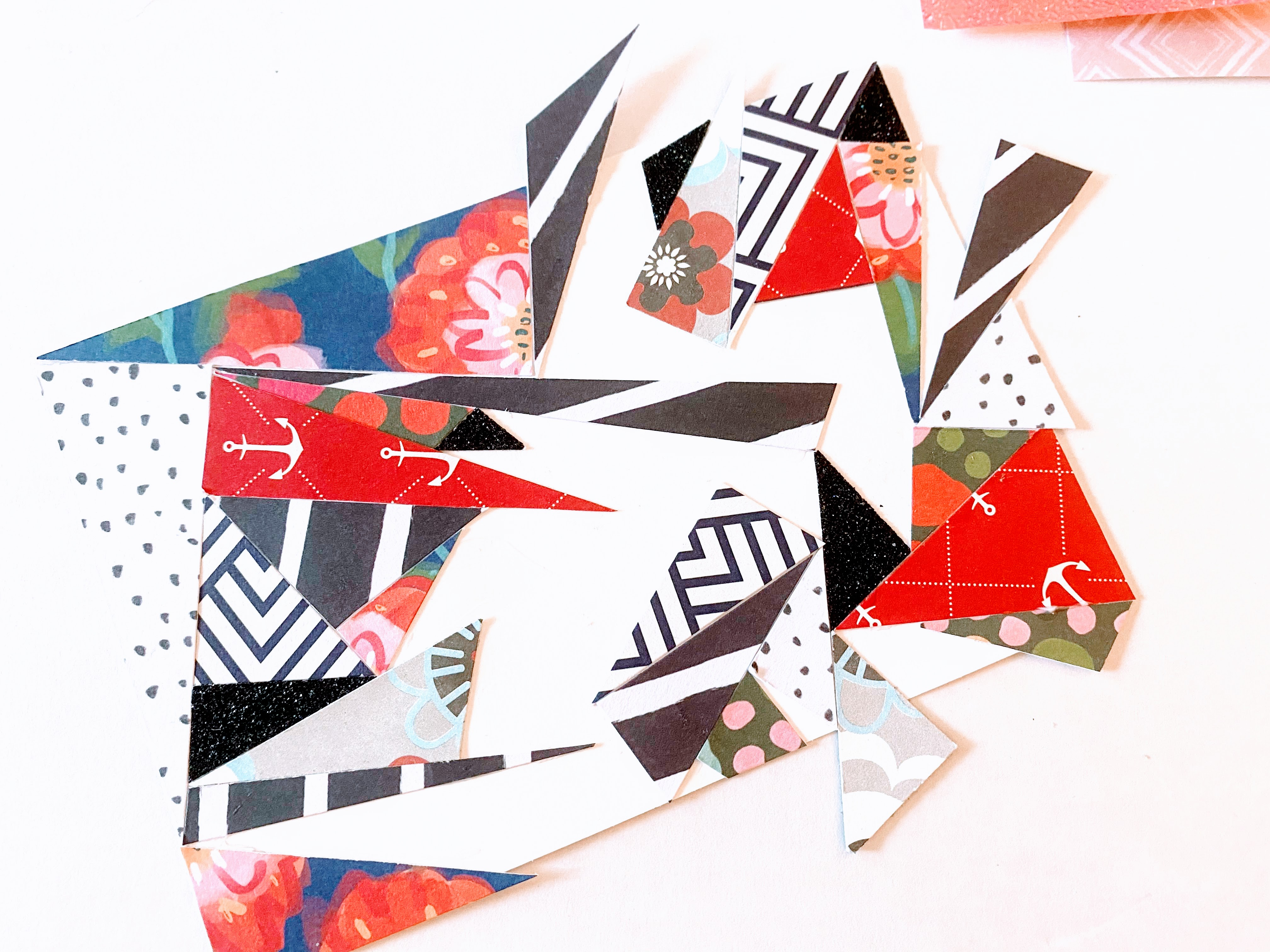 We used various patterned paper and placed it around the card, trying to fit the triangles together.