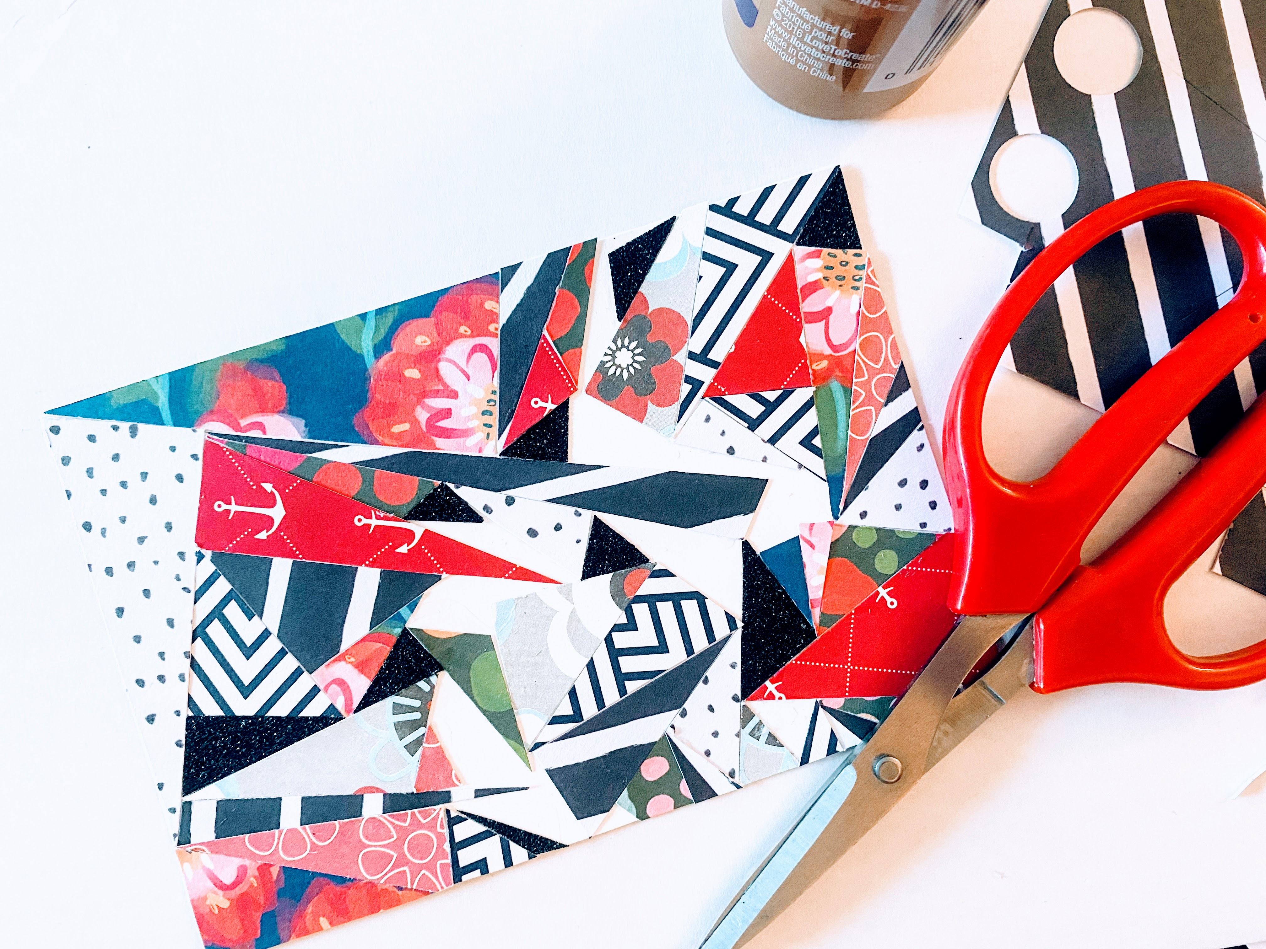 Here we tried to fill in the gaps by cutting smaller triangles to fit in between larger triangles of our abstract art card.