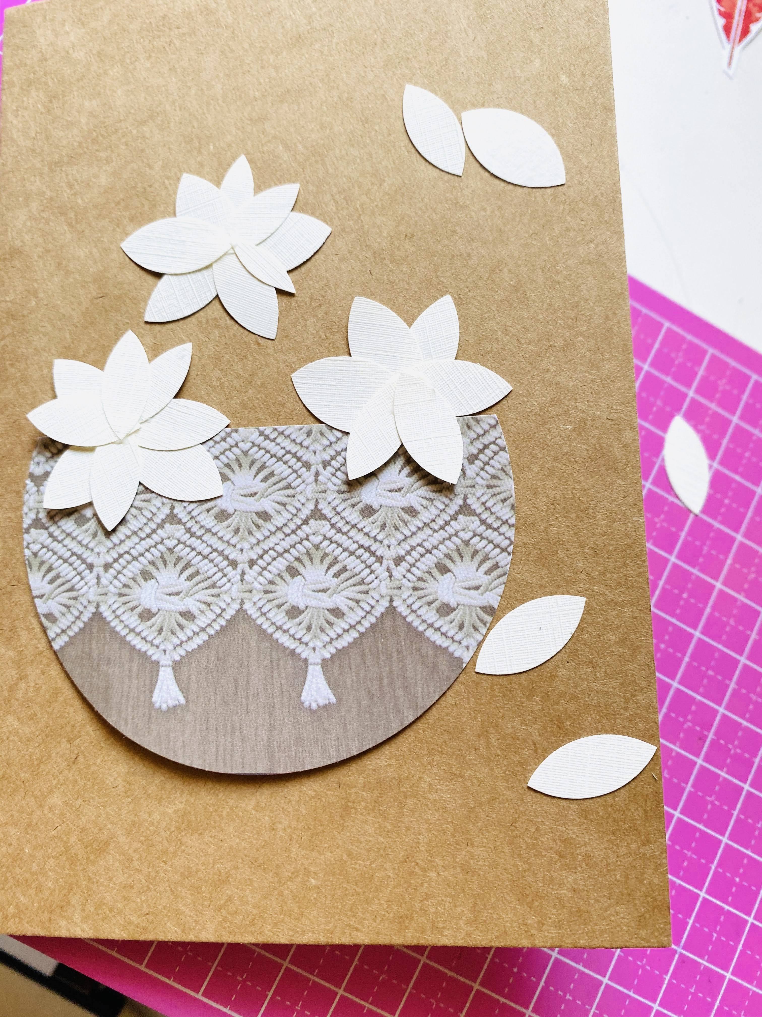 Forming magnolia flowers out of textured paper and making a flower basket for a homemade card.