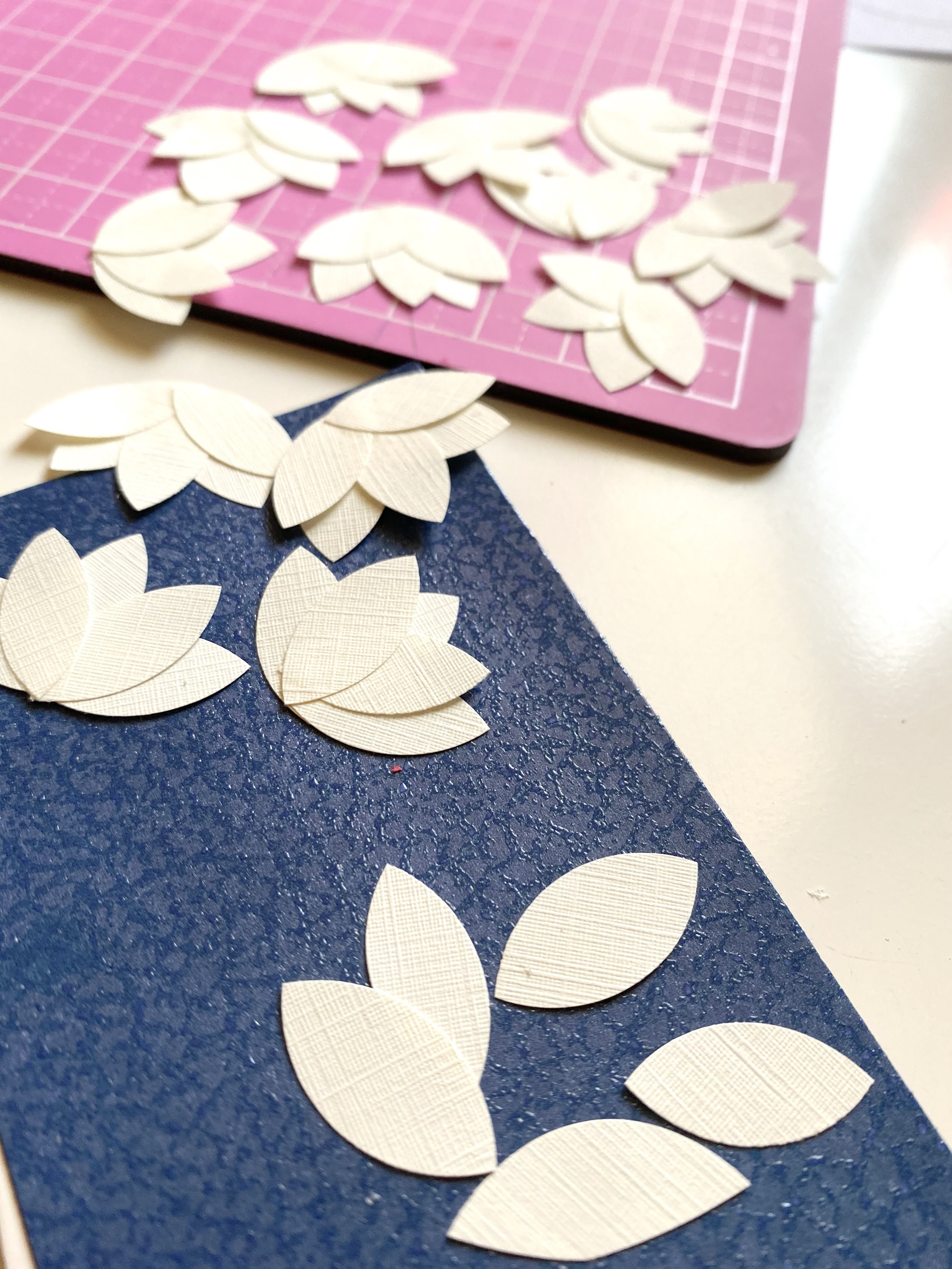 Making magnolia flowers out of textured resume paper for a homemade card.
