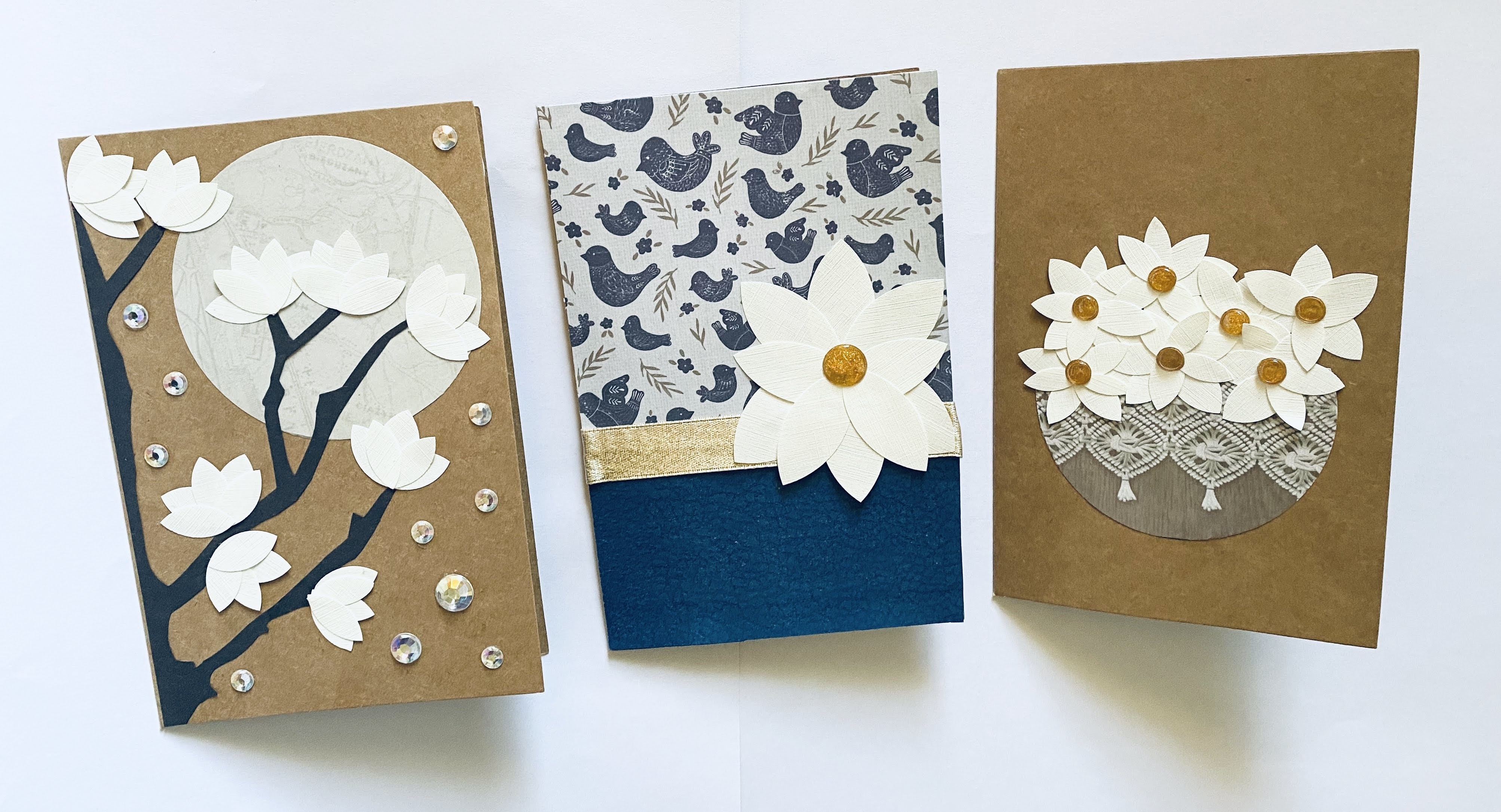 Homemade magnolia cards.  Magnolias by the moonlight, a magnolia flower basket, and a magnolia flower with patterned paper.