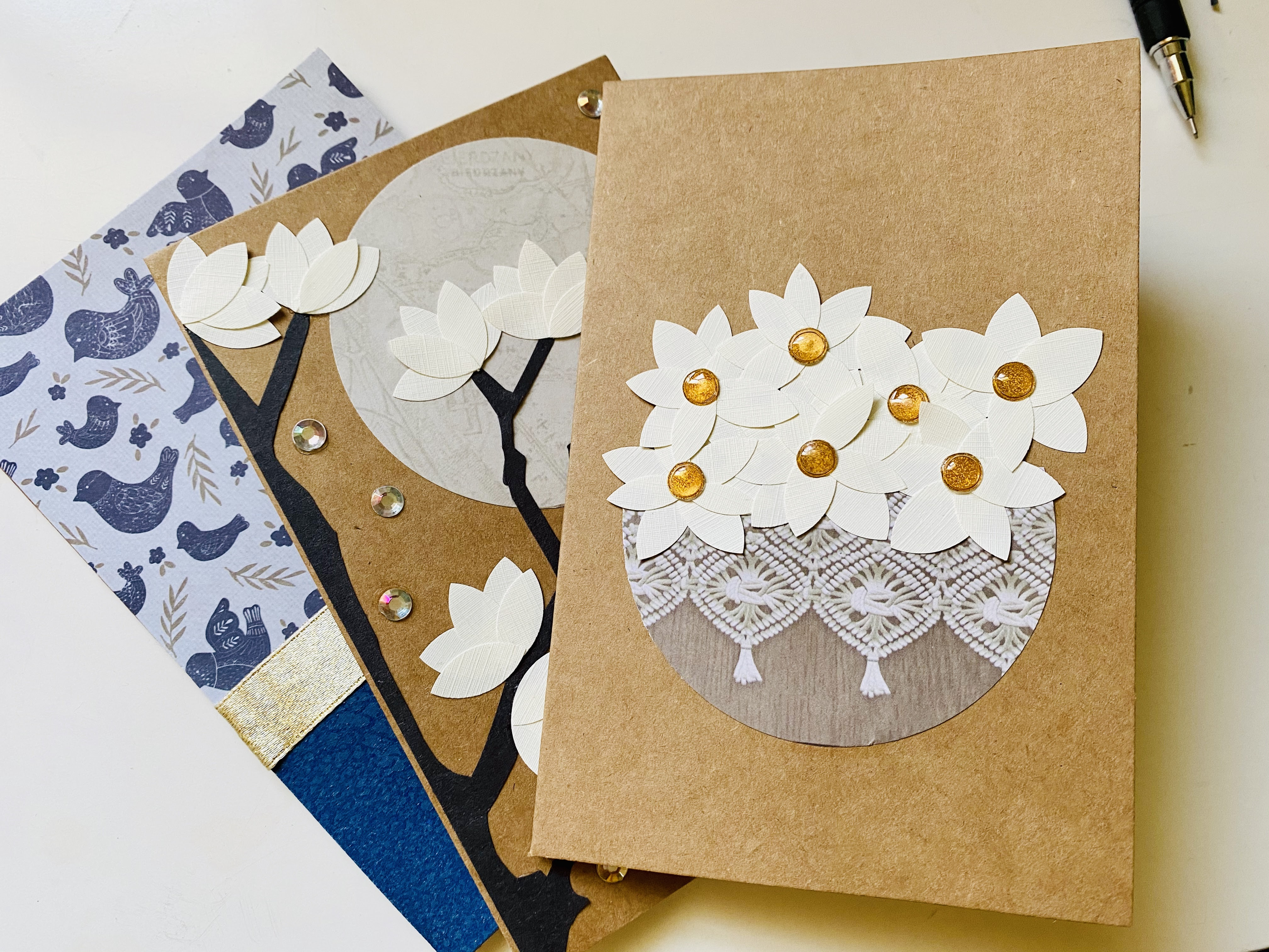 Using textured resume paper or off-white textured paper to create flower petals for magnolia cards.