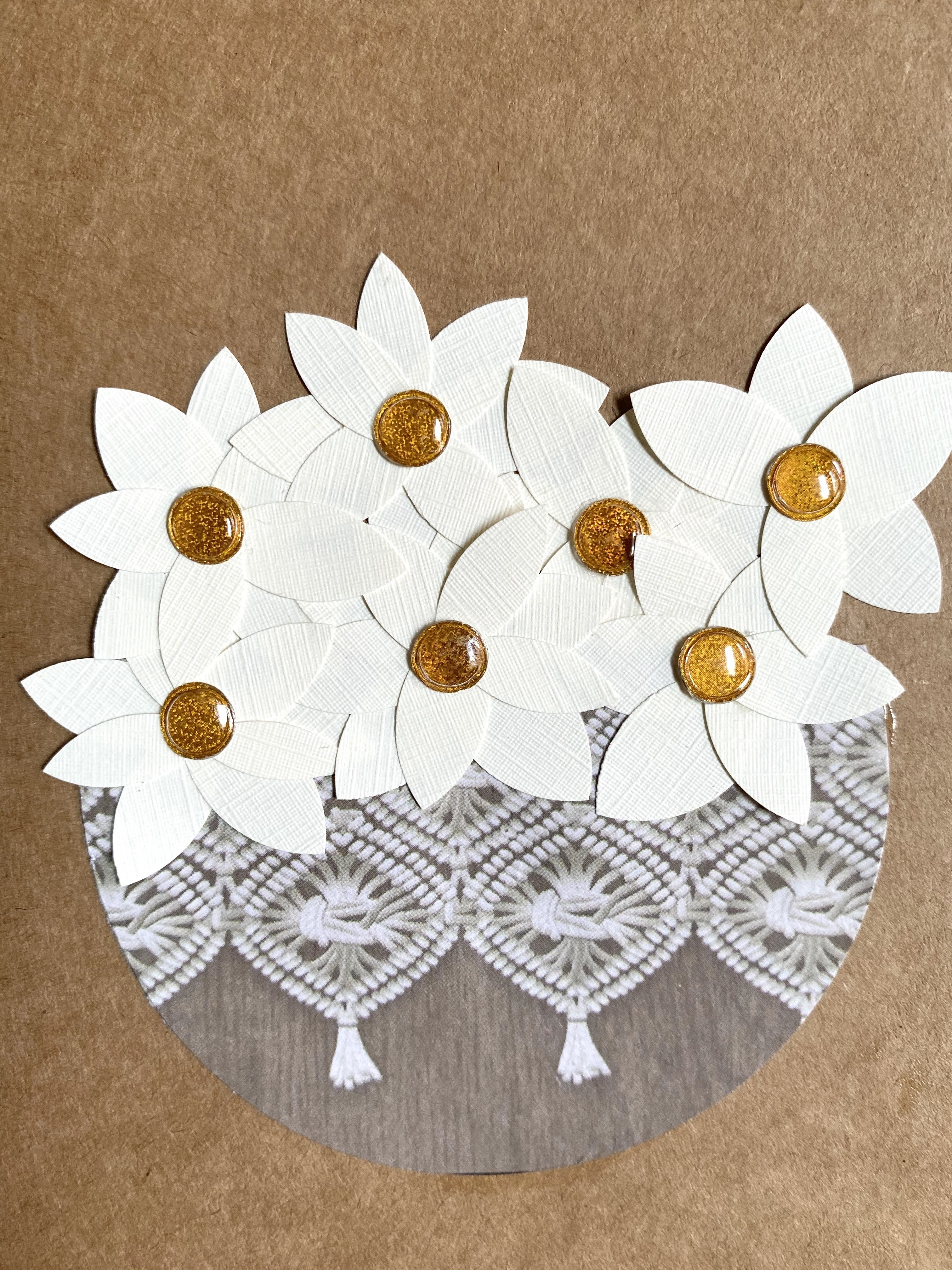 A homemade card made of scrapbook paper and resume paper to form a group of magnolias in a flower basket.  A simple and earthy homemade card.