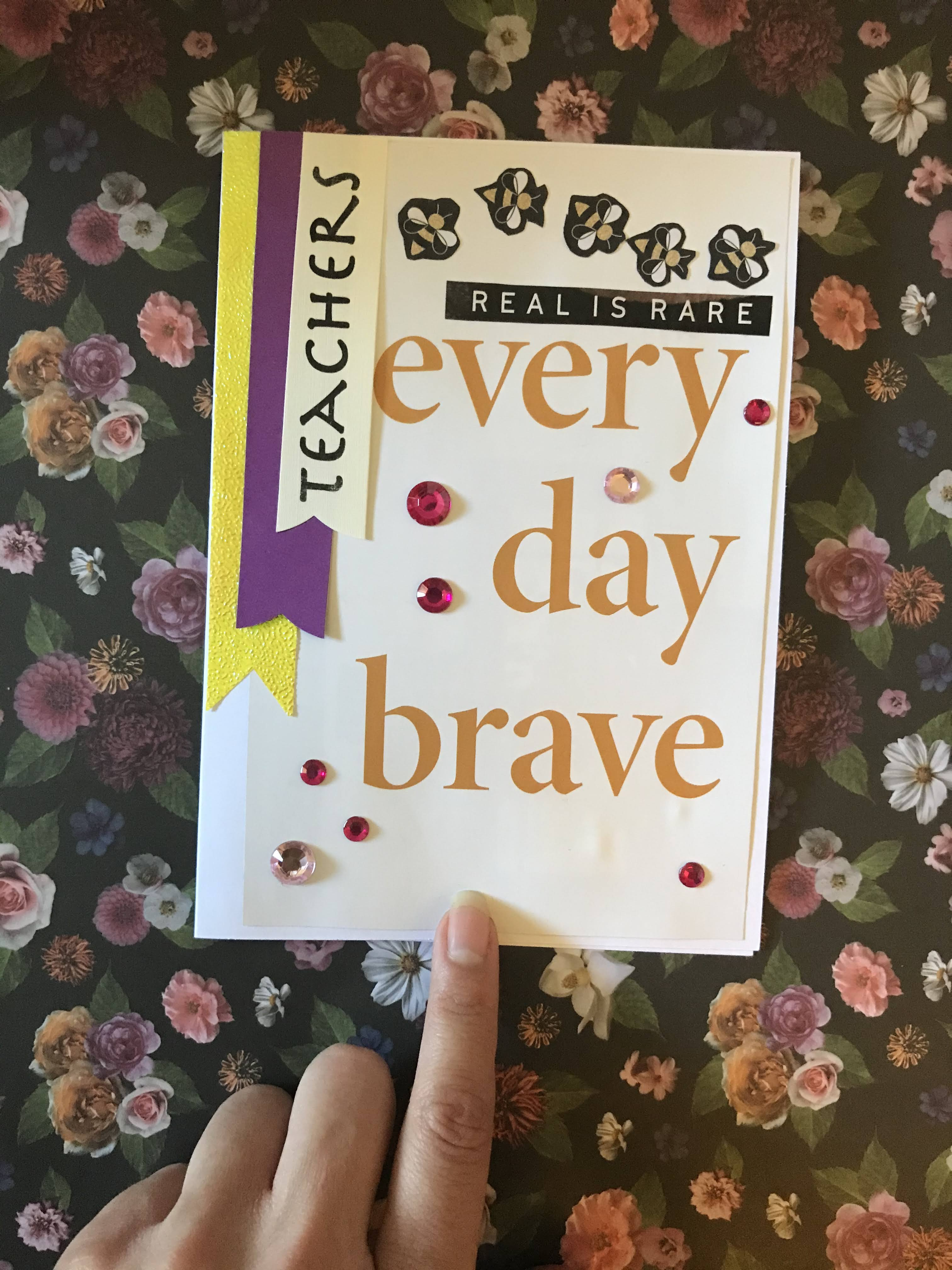 """Front of card with """"every day brave"""" phrase and banner lettering with gem stones"""